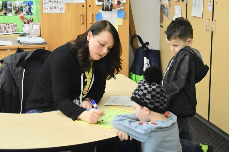 PMG PHOTO: EMILY LINDSTRAND - Young students in Estacada work with an educational assistant.