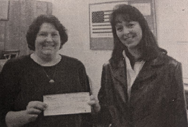 ARCHIVE PHOTO - In 1980, Boring Jackpot owner Amy Denman donated $500 to the Estacada Youth Basketball program. Here, she presents a check to coach Denise Carey.