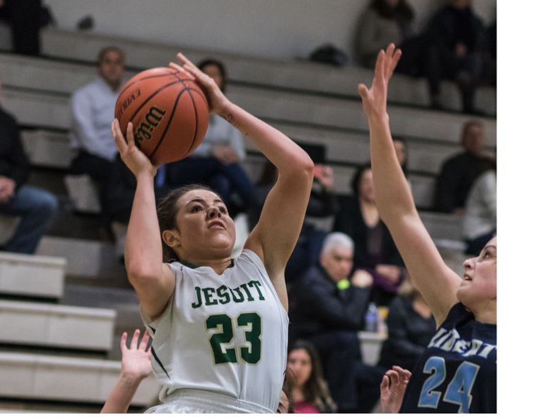 TIMES PHOTO: MATT SINGLEDECKER - Jesuit senior guard Taylor Freeman tore her ACL on February 1, but is back and going all out for the Crusaders.