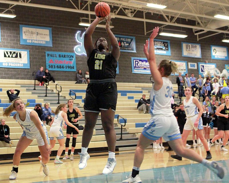 PMG PHOTO: MILES VANCE - West Linn junior post Aaronette Vonleh goes up for two of her game-high 38 points during her team's 66-44 win at Lakeridge High School on Tuesday, Jan. 14.