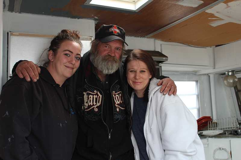 DESIREE BERGSTROM/MADRAS PIONEER - Melissa Wheeler, left, and Michelle Valentine, right, spent a week fixing up a donated camp trailer to give Rod Sanders a place to live after he spent two and a half years living on the streets. To learn more, check out the story on page A10.
