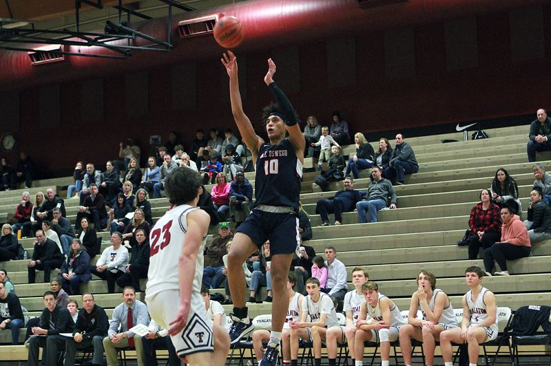 PMG PHOTO: MILES VANCE - Lake Oswego junior post Trace Salton shoots a stepback jumpshot during his team's 65-50 win over Tualatin at Tualatin High School on Tuesday, Jan. 14.