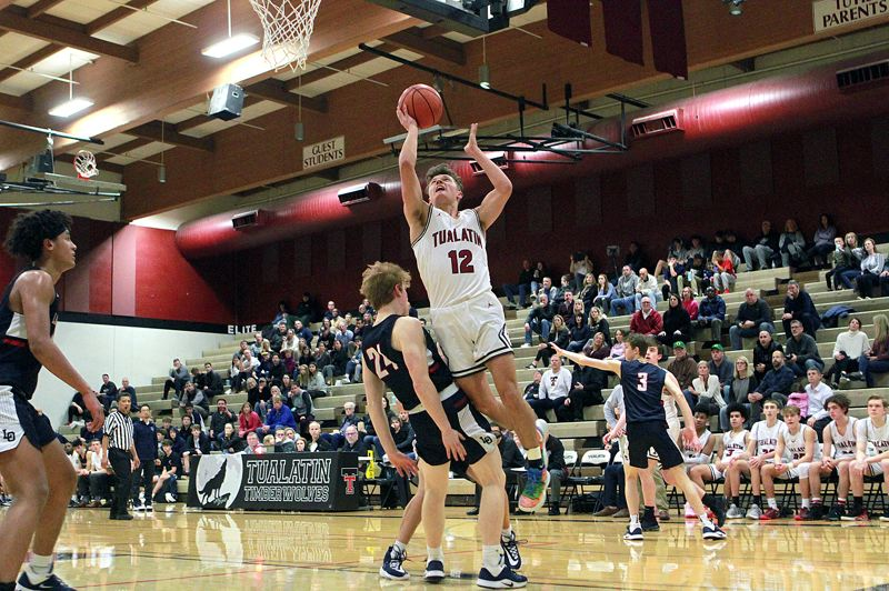 PMG PHOTO: MILES VANCE - Tualatin senior guard/wing Sam Noland goes up for a shot during his team's 65-50 loss to Lake Oswego at Tualatin High School on Tuesday, Jan. 14.