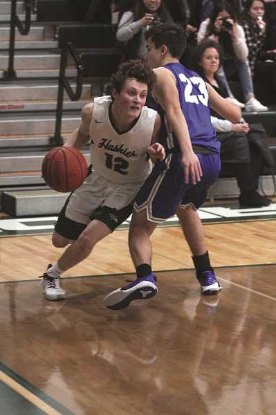 PMG PHOTO: PHIL HAWKINS - North Marion senior Brady Hansen was second on the team with 13 points, going 8-of-13 from the free throw line.