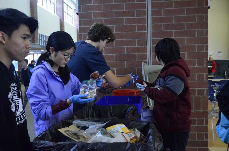 COURTESY PHOTO  - The LOHS Green Team helped sort classmates trash during a waste audit in 2019.