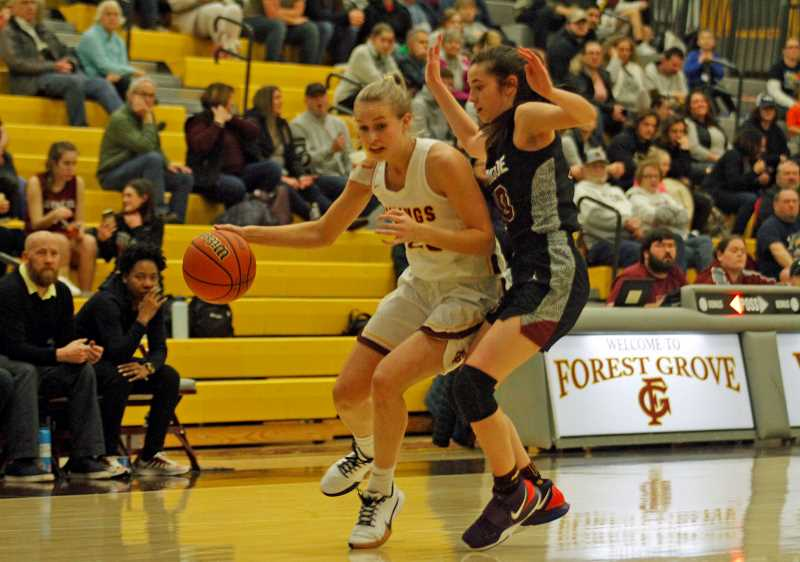 PMG PHOTO: WADE EVANSON - Forest Grove's Amanda Rebsom dribbles around Glencoe's Bella Martinez during the Vikings game against the Crimson Tide Wednesday night, Jan. 15, at Forest Grove High School.