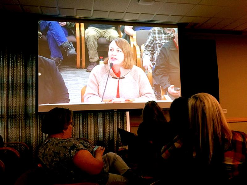 OREGON CAPITAL BUREAU/JAKE THOMAS - State Rep. Rachel appears on a screen in a legislative hearing room used to accommodate overflow Wednesday, Jan. 15. The topic was a safe gun storage proposal she plans to introduce in the 2020 legislative session.