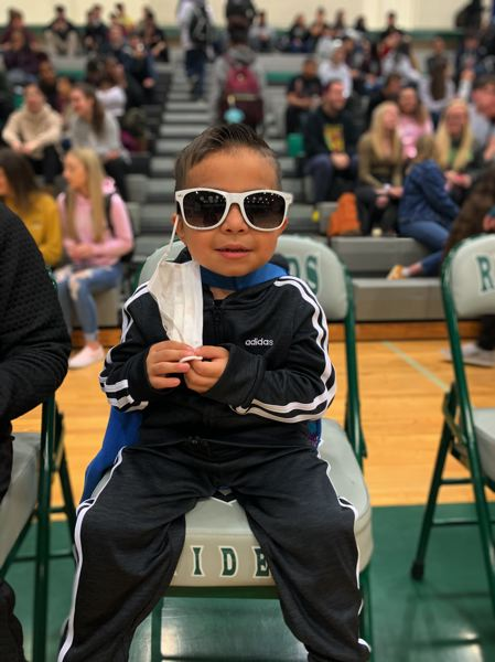 COURTESY PHOTO: SPARROW CLUBS - Little Noah, the newest Raider, takes in the scene at a recent assembly at Reynolds High School.