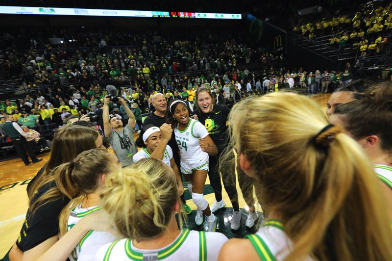 PMG PHOTO: JAIME VALDEZ - Oregon players and coach Kelly Graves huddle after defeating Stanford at Matthew Knight Arena.