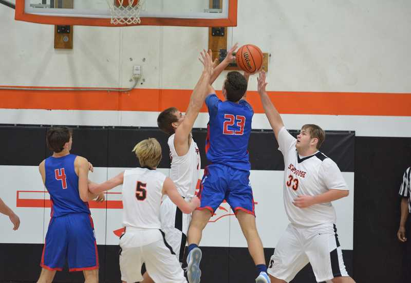 PMG FILE PHOTO - Scappoose boys basketball senior Tommy McKedy and the Indians beat Hillsboro in their NWOC opener.