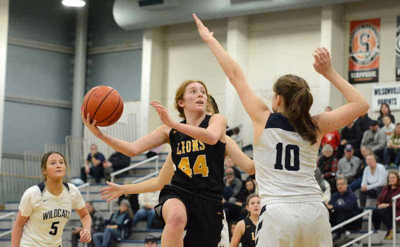 PMG PHOTO: DEREK WILEY - St. Helens senior Madison Holm led the Lions with a team-high 14 points against Wilsonville.