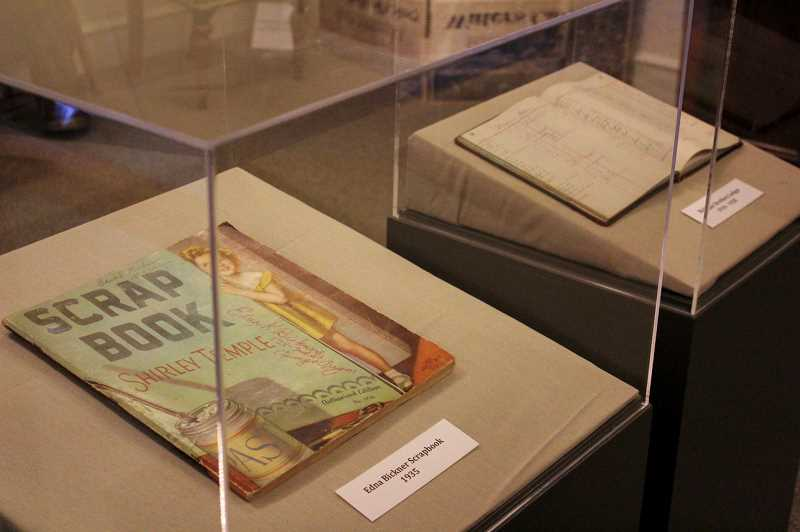 PMG PHOTO: CLARA HOWELL  - There are items like scrapbooks and store ledgers on display from the Bickner family.