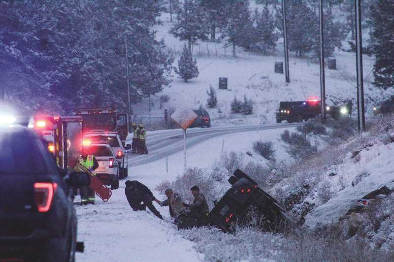 Three escape serious injury in rollover crash