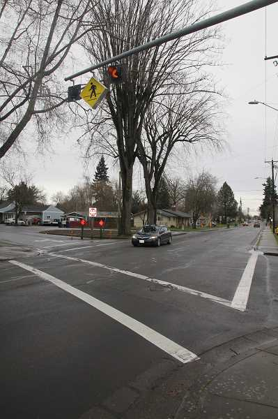 PMG PHOTO: JUSTIN MUCH - A contract has been approved for the evaluation and design of the Hayes Street/Settlemeir intersection in Woodburn. Some options that come out of it could include a signal and may affect the salient trees at that location.