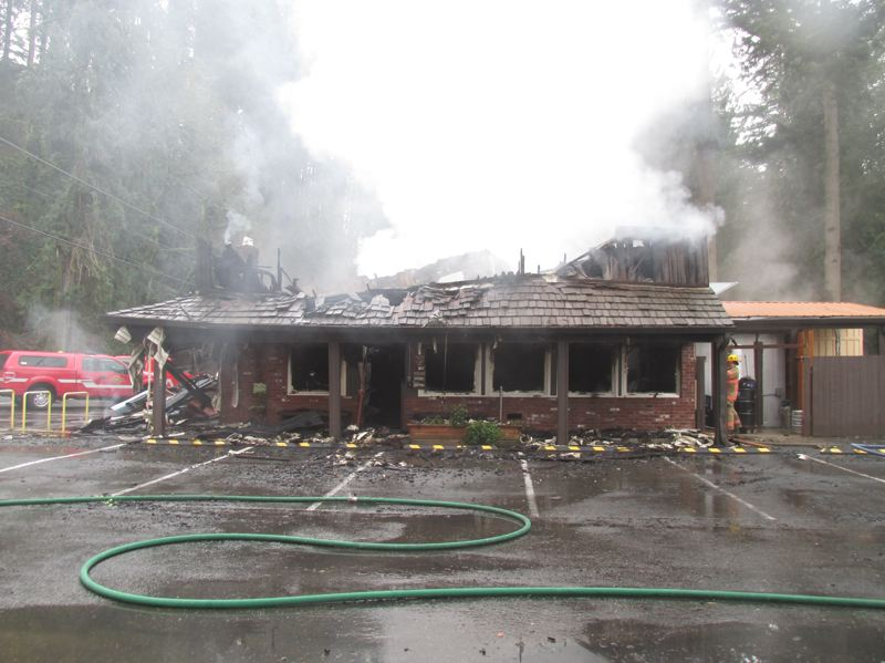 PMG PHOTO: SHANNON O. WELLS  - Part of the ground floor is all that remains of Shirley's Tippy Canoe Restaurant and Lounge after a fire that may have started in the second floor office destroyed the mostly wood-framed 1946-vintage building.