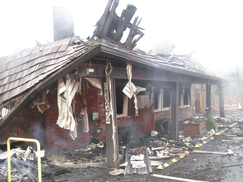 PMG PHOTO: SHANNON O. WELLS - A Friday morning fire wrought extensive destruction to the entranceway to the popular Shirley's Tippy Canoe restaurant along the Sandy River just southeast of Troutdale.