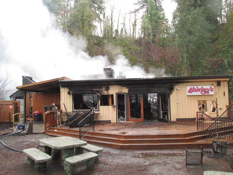 PMG PHOTO: SHANNON O. WELLS - A view from the popular back patio of Shirley's Tippy Canoe reveals the extent of fire destruction to the the two-story building that has served food, drink and entertainment in various incarnations since the late 1940s.