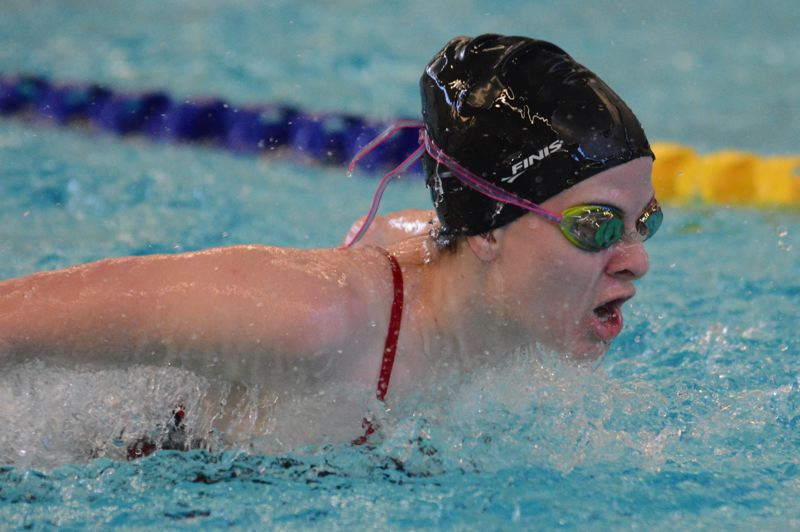 PMG PHOTO: DAVID BALL - Sandys Tamzyn Pendleton pushes through the water during the opening butterfly leg on her way to second place in the 200 medley race.