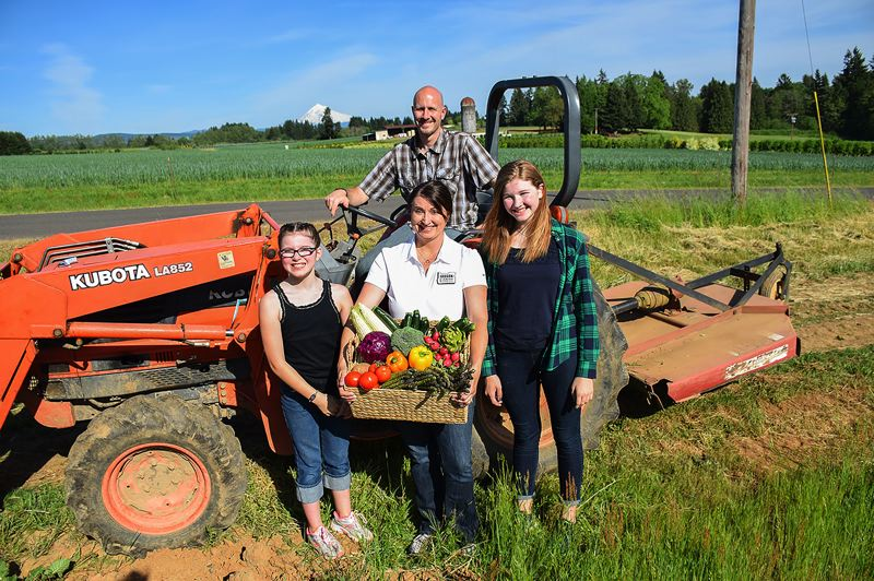 COURTESY PHOTO: VERNA JEAN NURSERY - Angi Bailey, center, with her husband, Larry, and daughters Abbi, left, and Katie, is headed to Austin this weekend to represent the Oregon Farm Bureau, to which she was elected First Vice President in December.