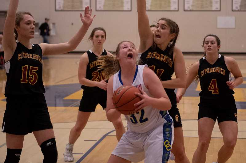 LON AUSTIN/CENTRAL OREGONIAN - Grace Brooks goes to the basket for two of her team-high 10 points in the Cowgirls' game against The Dalles Riverhawks Friday night. The Cowgirls lost 47-45.