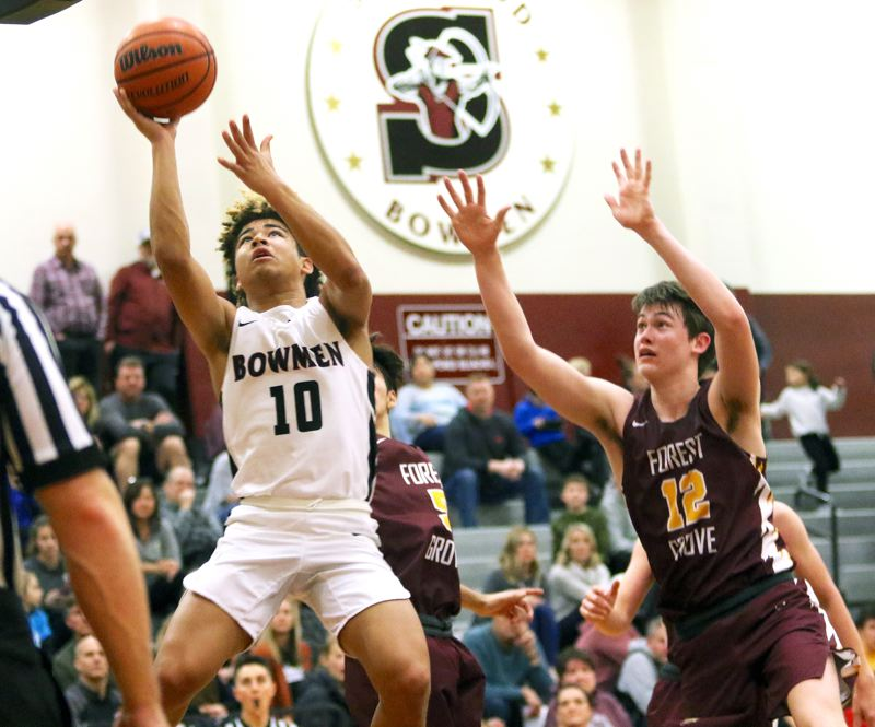 PMG PHOTO: DAN BROOD - Sherwood High School senior guard Jamison Guerra (10) goes up to the basket during the Bowmen's conference game with Forest Grove. Guerra had eight points, 10 rebounds and 10 assists in Sherwood's 57-32 victory.