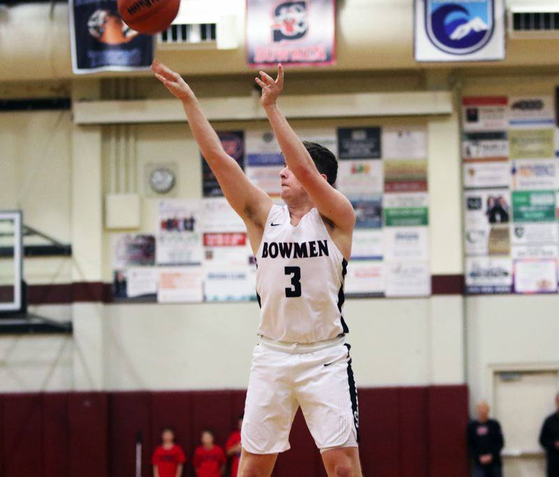 PMG PHOTO: DAN BROOD - Sherwood High School junior guard Caden Davis shoots a 3-pointer during the Bowmen's game with Forest Grove. Davis sank five 3-pointers in the Bowmen's 57-32 victory.