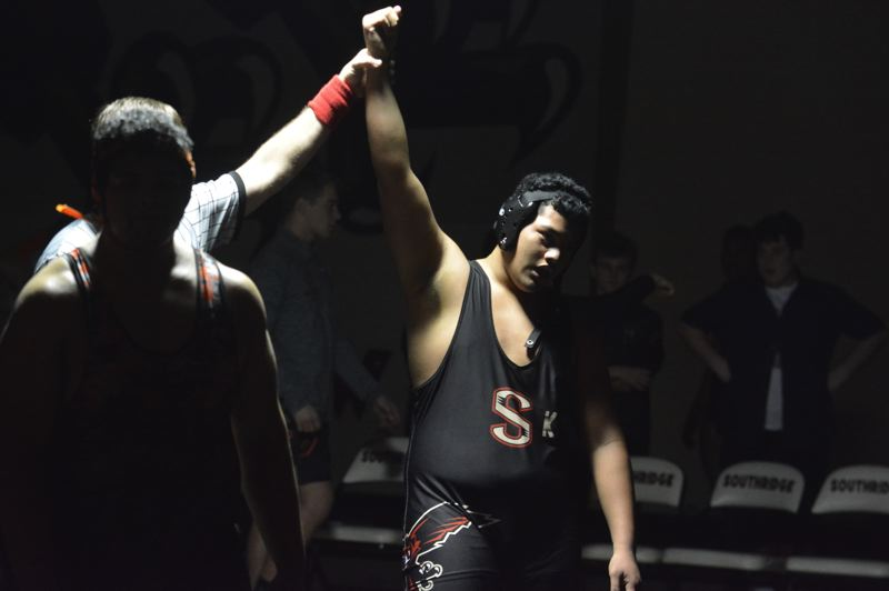 TIMES PHOTO: MATT SINGLEDECKER - Southridge heavyweight Nomani Liu won his bout against Beaverton to help the Skyhawks win their second Metro meet.