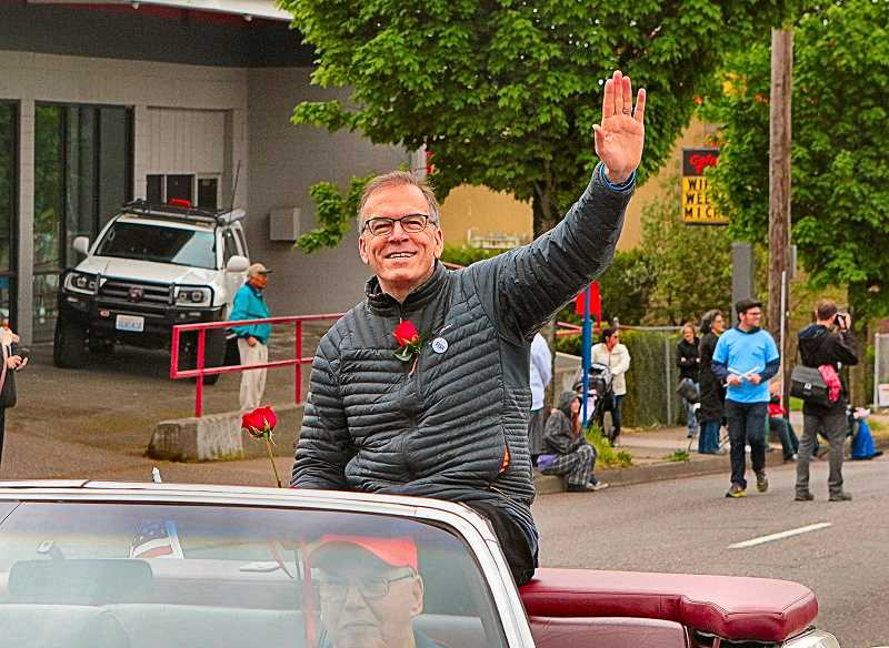 DAVID F. ASHTON - During the Spring 2018 82nd Avenue of Roses Parade, Nick Fish waved to onlookers along the way. He was often the only City Commissioner to appear at major Southeast Portland events.