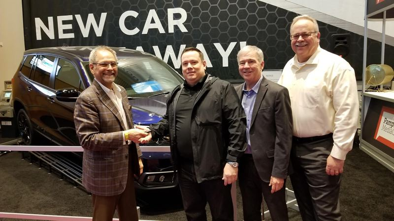 CONTRIBUTED - The new car giveaway ceremony at the 2019 Portland International Auto Show.