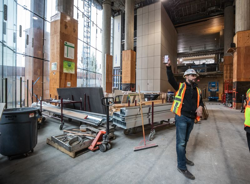 PMG PHOTO: JONATHAN HOUSE - Josh Durham, Hoffman project manager, talks about the architecture of the new Central Courthouse.