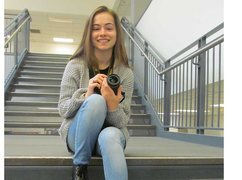PHOTO BY ELLEN SPITALERI - Kristen Wesson takes her camera to special events at Milwaukie High School, so she can capture the high school experience for the yearbook.