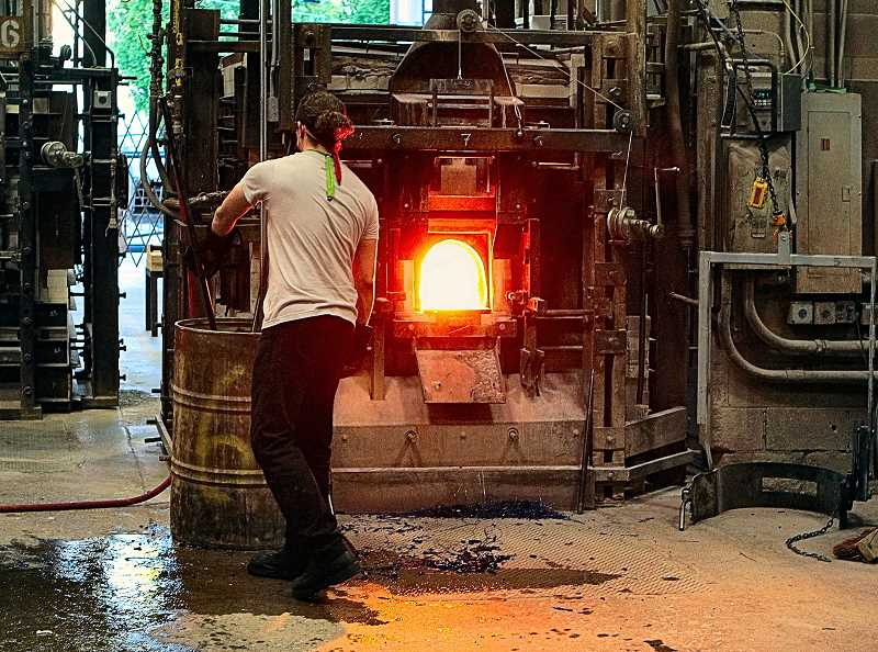 DAVID F. ASHTON - Exhaust from glass melting furnaces at Bullseye Glass Company, such as this one, are filtered to far exceed new Cleaner Air Oregon regulations, according to the company.