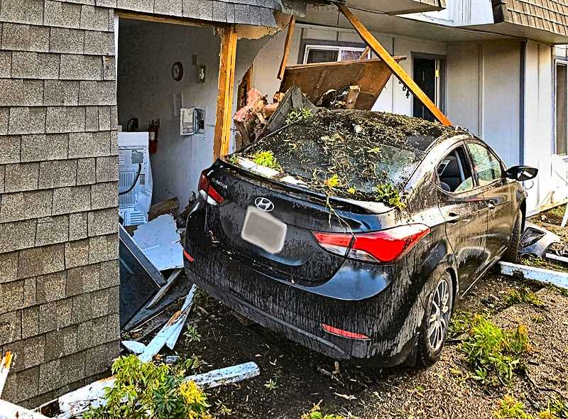 COURTESY RODNEY ROCKER & KATU-TV2 NEWS - Witnesses said the driver of this Hyundai was speeding far beyond the 20 mph residential speed limit, before blowing through a stop sign and smashing into this Inner Southeast apartment building, on New Years morning.