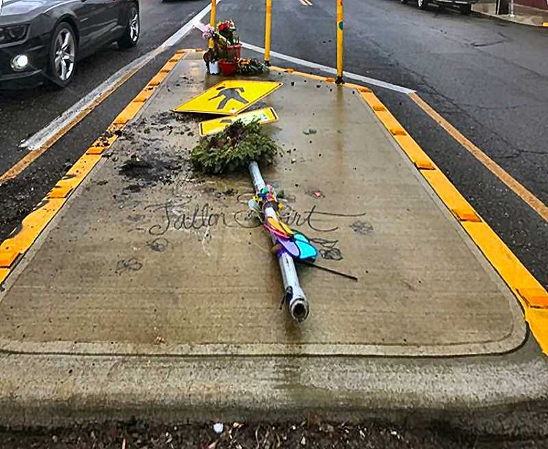 ZANE SPARLING - A mid-street memorial to slain Franklin High student Fallon Smart was itself struck by a hit-and-run driver who drove into the pedestrian island at S.E. Hawthorne Boulevard and 43rd Avenue sometime early Saturday, January 4.