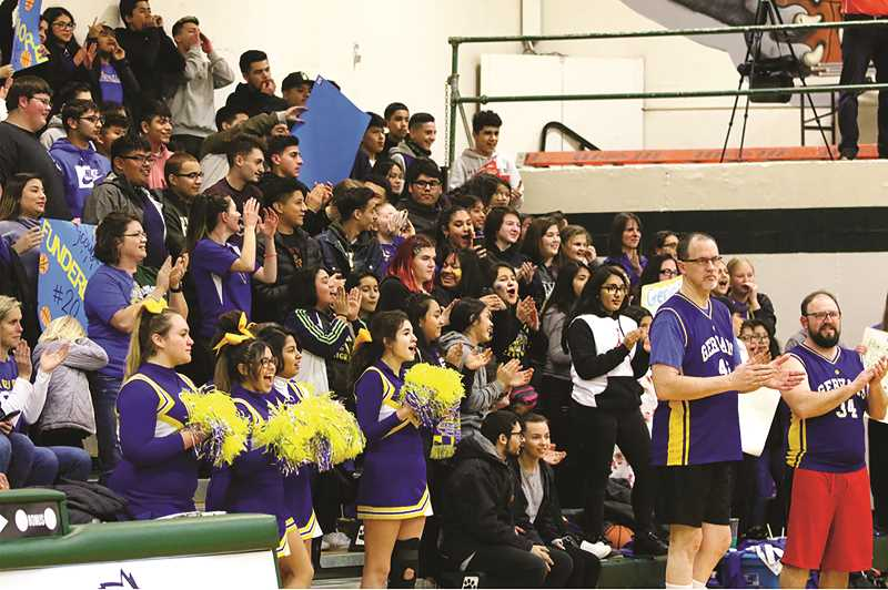 COURTESY PHOTO: JO WHEAT - Students and community from both schools filled the stands at North Marion High School last year for the Gervais-North Marion staff basketball game.