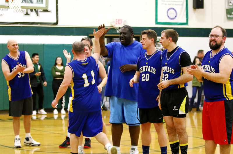 COURTESY PHOTO: NORTH MARION SCHOOL DISTRICT - The North Marion-Gervais staff basketball game is a revival of a former fundraiser. The two school played each other in 1969 and 1970.