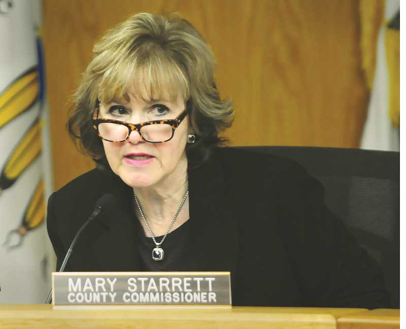 GRAPHIC PHOTO: GARY ALLEN - Commissioner Mary Starrett speaks Thursday during the hearing.