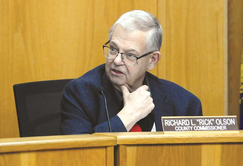 GRAPHIC PHOTO: GARY ALLEN - Commissioner Rick Olson questions staff during the hearing Thursday in McMinnville.