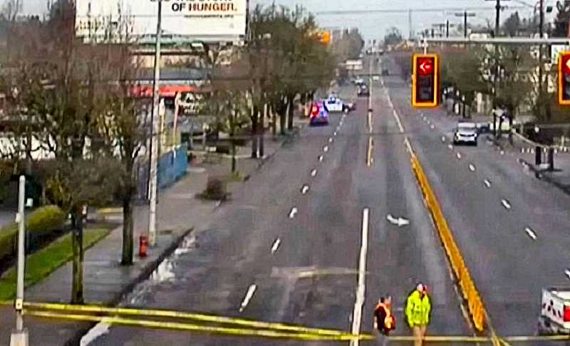 COURTESY PBOT - Just north of S.E. Powell Boulevard, along 82nd Avenue of Roses, a still image from this PBOT Traffic Camera showed the area that police had closed down for atime, after a pre-Christmas shooting.