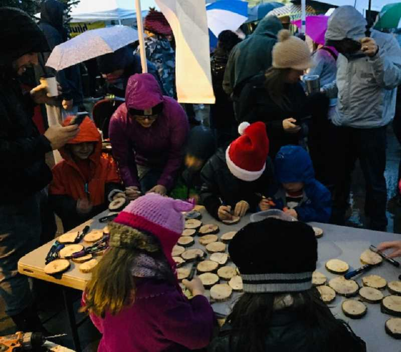 COURTESY PHOTO - Children make ornaments during the Downtown Oregon City Tree Lighting Ceremony on Dec. 7.