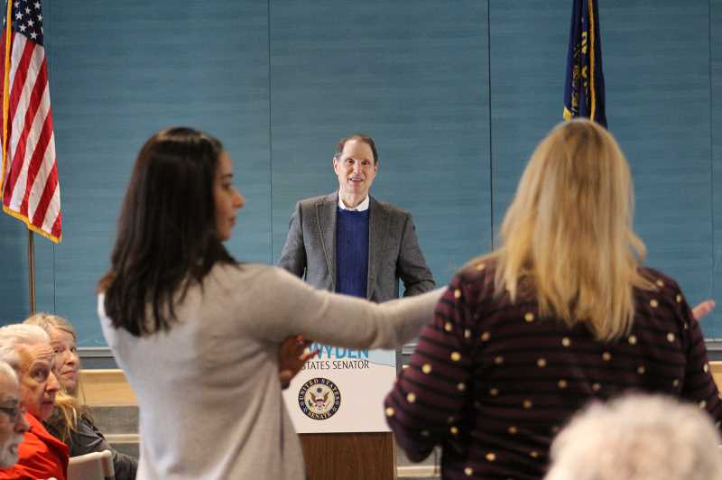PMG PHOTO: COREY BUCHANAN - U.S. Sen. Ron Wyden listens to a question from an audience member during the town hall at Meridian Creek Middle School on Saturday, Jan. 18.