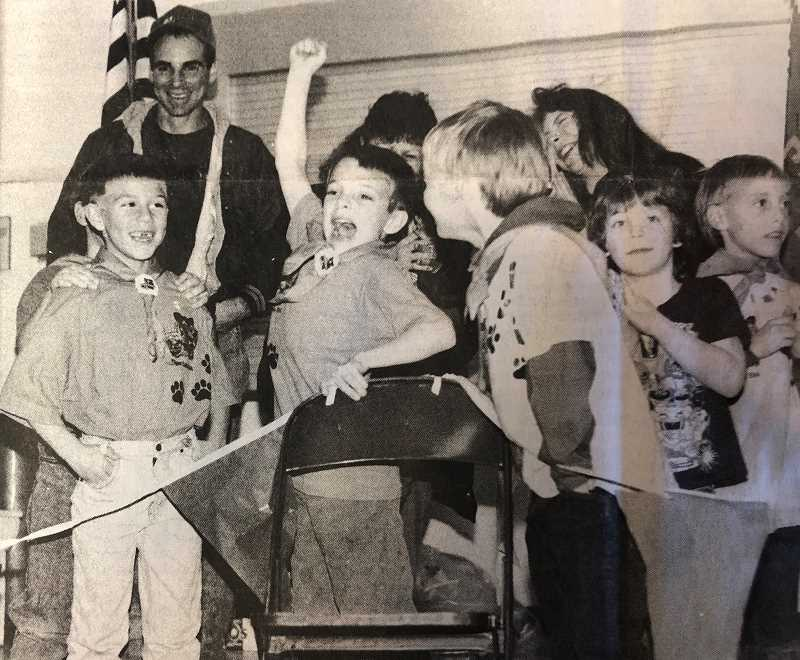 CENTRAL OREGONIAN - JANUARY 19, 1995: Hard work pays off. A Cub Scout den rejoices when a homemade pine car belonging to one of its members makes excellent time. Pack #28 had its Pine Derby last Thursday at Ochoco School.