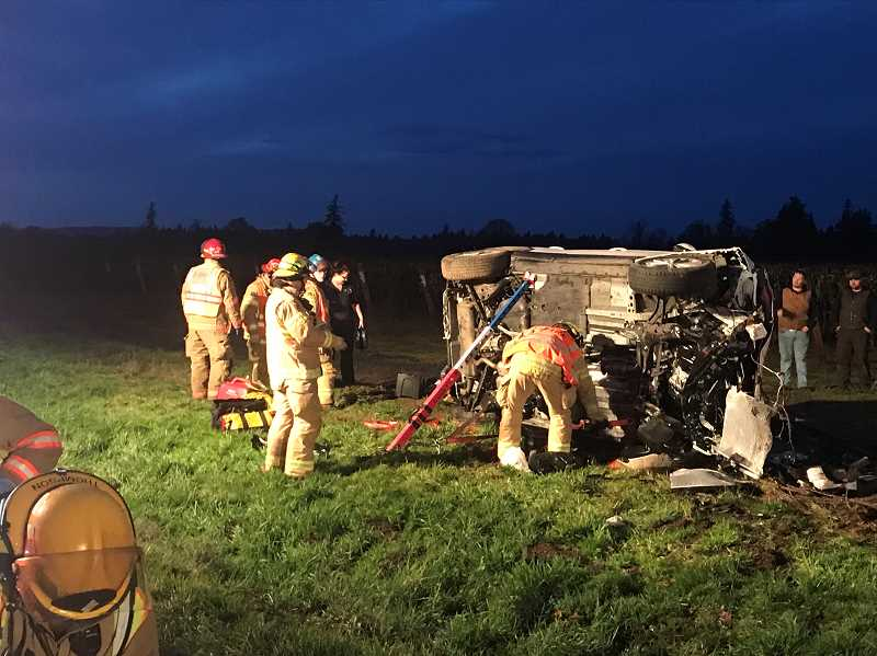 MARION COUNTY SHERIFFS OFFICE - First responders attend to a single-vehicle roll over took place on McKay Road Sunday afternoon.