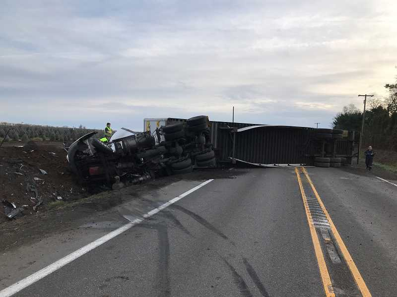 MARION COUNTY SHERIFFS OFFICE - A semi-truck pulling a trailer full of potato chips crashed head on with a Jeer Cherokee Monday morning, overturning and blocking Ehlen Road in the process.