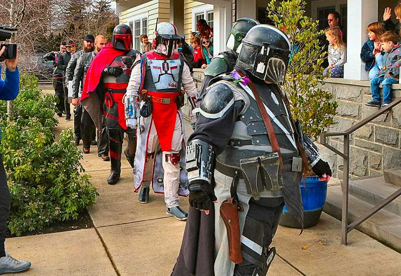 DAVID F. ASHTON - To the delight of the kids - all clients of The Dougy Center for Grieving Children on S.E. 52nd - members of the Mandalorian Mercs Costume Club march in.
