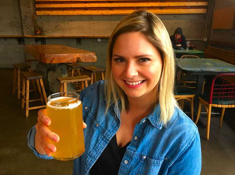 PAIGE WALLACE - Wildland Kombucha founder, brewer, and Brentwood-Darlington resident Jillian Bohrer enjoys a glass of her own CBD Lemongrass booch at Base Camp Brewing, where its available on tap.