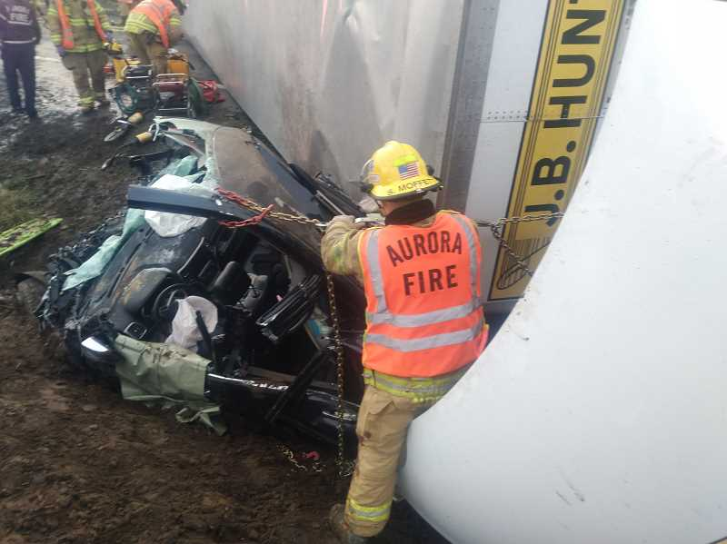 COURTESY PHOTO: AURORA FIRE DISTRICT - Emergency responders from Aurora and St. Paul fire districts worked to remove a woman from her crushed vehicle on Monday morning. The driver was transported to a nearby trauma hospital with moderate injuries.