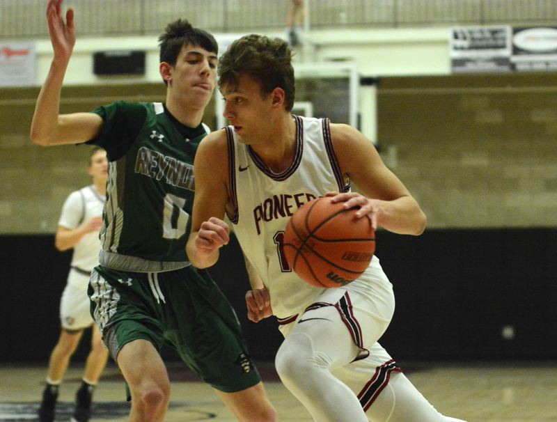 PMG PHOTO: DAVID BALL - Sandys Pierce Roeder drives the baseline against Reynolds defender Brandon Buffington. He finished with five 3-pointers and a game-high 29 points.