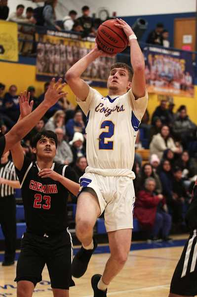 PMG PHOTO: PHIL HAWKINS - Gervais senior Alex Kalugin led the Cougars in scoring in back-to-back games, pouring in 18 against Western Christian on Thursday, followed by 11 against Chemawa on Friday.