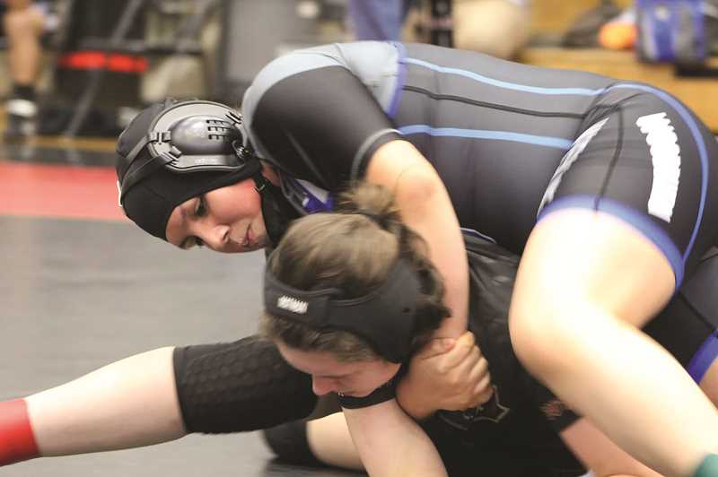 COURTESY PHOTO: WOODBURN WRESTLING - Woodburn's Jacky Perez placed fifth in the 155-pound bracket at the Southridge girls tournament, helping the Bulldogs take second place.